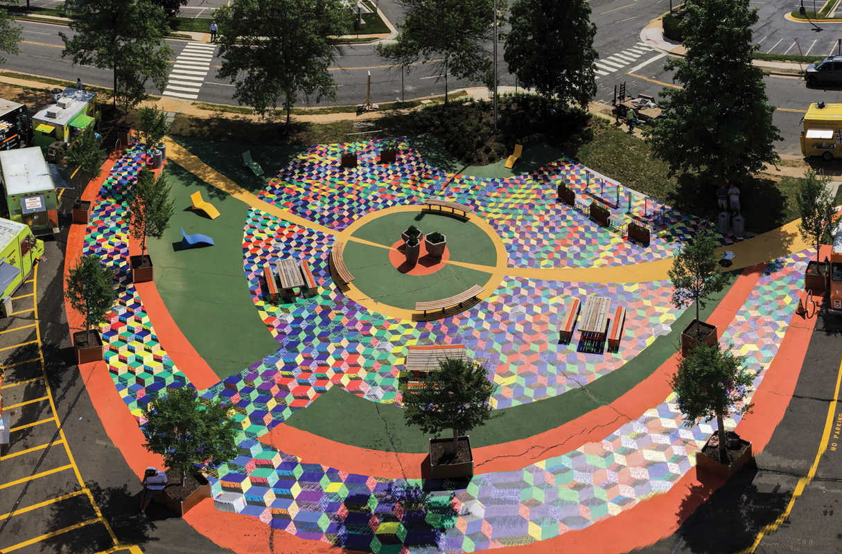 Artist Julia Vogl surveyed 1,000 people in roughly 20 locations around Tysons to create an ambitious community art project. Each respondent's answers were translated into a color-coded tile, and the tiles were then fit together to make this 5,000-square-foot ground mural. Here, from photographer Jennifer Heffner, is the story of how Tysons Tiles, currently on display through August 3, hit the pavement.